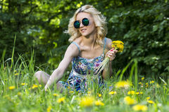Young woman in the park with flowers. Spring time Royalty Free Stock Photos