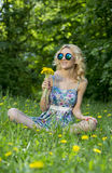 Young woman in the park with flowers. Spring time Royalty Free Stock Image