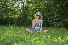 Young woman in the park with flowers. Spring time Stock Images