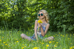 Young woman in the park with flowers. Spring time Stock Photos
