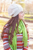 Young Woman In the Park. Looking at side. Autumn or winter season Royalty Free Stock Images