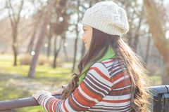 Young Woman In the Park. Looking at side. Autumn or winter season Stock Photography