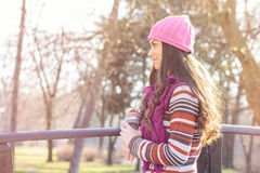 Young Woman In the Park. Looking at side. Autumn or winter season Royalty Free Stock Photos