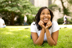 Young woman in the park. Looking thoughtful Royalty Free Stock Photo