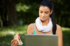 Young woman in park at lunchtime Stock Photography