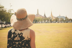 Young woman in park by palace Stock Photos