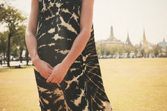 Young woman in park by palace Royalty Free Stock Photos