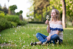 Young woman in the park royalty free stock photos