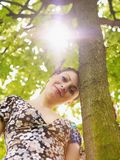 Young woman in park, smiling Royalty Free Stock Photography