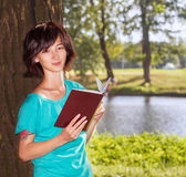 Young woman in the park Stock Images