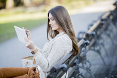 Young woman in park with tablet. Young woman in the park with tablet Stock Photos