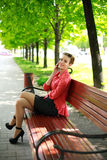 Young woman in a park talking on the phone Royalty Free Stock Photo
