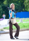 The young woman in park with a tripod. On a shoulder Stock Photo