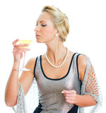 Young woman in party dress drinking. Royalty Free Stock Photos