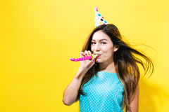 Young woman with party hat with noisemaker Royalty Free Stock Photos