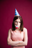 Young woman with party whistle Stock Photos