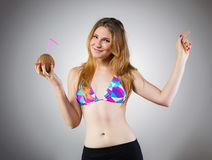 Young woman partying with coconut drink Royalty Free Stock Photo
