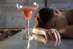 Young woman passed out on bar counter Royalty Free Stock Image