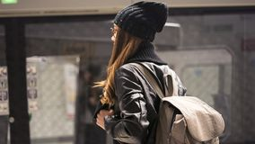 Young woman passenger in public train station in city royalty free stock photos