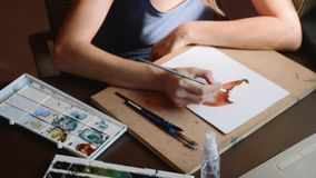 Young woman passes a lesson in watercolor painting online at home stock video