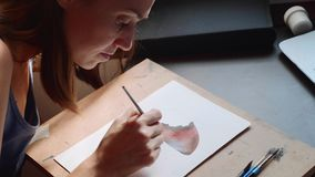 Young woman passes a lesson in watercolor painting online at home stock video footage
