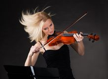 Young woman passionately playing violin Royalty Free Stock Photo