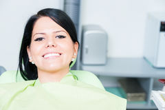Young woman patient smiling cute at dentist. After bleaching or whitening royalty free stock photography
