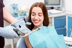 Young woman patient visiting dentist in the dental Royalty Free Stock Photography