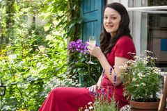 Young woman on a patio Stock Photography