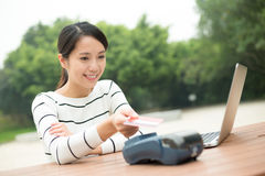 Young Woman pay on pos terminal with credit card. At outdoor Stock Photography
