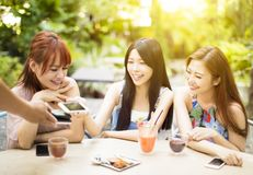 Young woman paying bill with smart phone. Young women paying bill with smart phone in restaurant Royalty Free Stock Photos