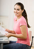 Young woman paying bills Stock Photography