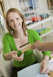 Young woman Paying for Clothes with Credit Card Stock Image