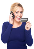 Young Woman Paying by Credit Card and Cell Phone Royalty Free Stock Image