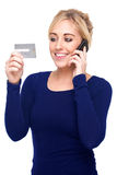 Young Woman Paying by Credit Card and Cell Phone Stock Photo