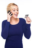 Young Woman Paying by Credit Card and Cell Phone Stock Images