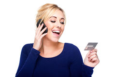 Young Woman Paying by Credit Card and Cell Phone Royalty Free Stock Photo