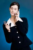 Young woman paying with credit card by phone royalty free stock images
