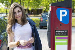 Young woman paying for parking outdoors Royalty Free Stock Photos