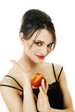 Young woman with peach Royalty Free Stock Photos
