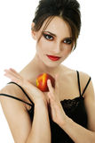 Young woman with peach Royalty Free Stock Photo