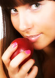Young woman with a peach Royalty Free Stock Photography