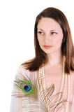 Young woman with a peacock feather. Stock Photos