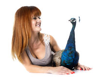 Young woman and peacock royalty free stock photos