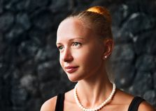 Young woman with pearl necklace and earrings Stock Images