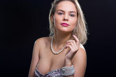 Young woman with pearls. Beautiful young woman with pearls Royalty Free Stock Image