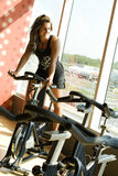 Young woman on pedal bike looking outside Royalty Free Stock Photography