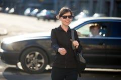 Young woman on pedestrian crosswalk Stock Photos