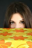 Young woman peeking Royalty Free Stock Photos
