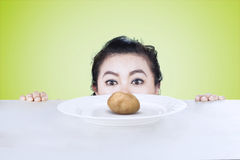 Young woman peeking boiled potato Royalty Free Stock Photos